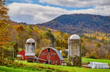 Farm With Red Barn And Silos At Sunny Autumn Day In West Arlington, Vermont, USA