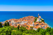 Iconic Aerial View Of Harbor Fishing Town Of Piran, Slovenia On The Adriatic Sea Riviera In The Mediterraniean Sea