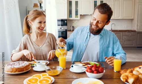 Keuken foto achterwand Kruidenierswinkel family happy couple have Breakfast in kitchen in morning