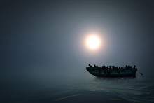 Refugees In A Boat On The Sea. Hopeless People. Dark Colour And Mysterious Atmosphere. 3D Render.