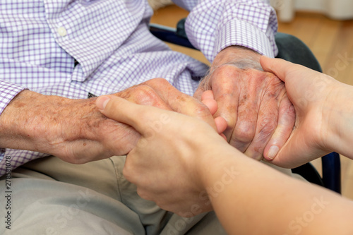 Canvas Print Detail of young and old human hands holding each other.