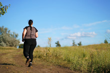 Weight Loss, Outdoor Activity, Exercising, Healthy Lifestyle, Jogging. Overweight Woman Running On Summer Meadow