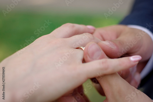 Fototapety, obrazy: The groom puts the ring on the bride. Wedding ceremony
