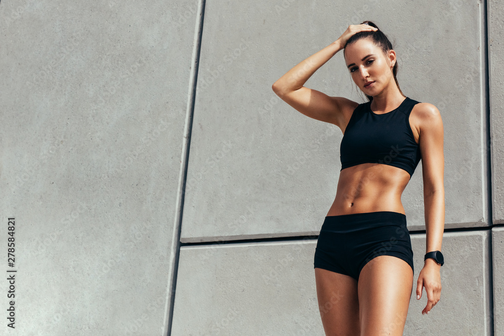 Fototapety, obrazy: Female athlete feeling tired after workout