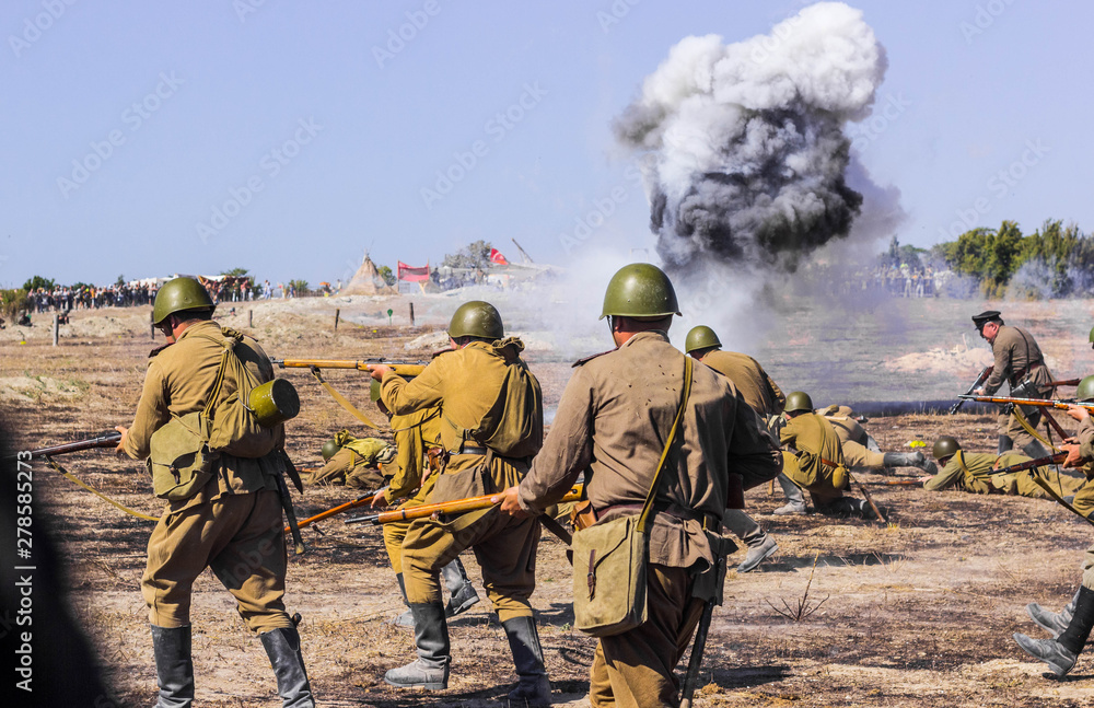 Fototapeta Explosions of bombs and shells. Reconstruction of the battle of world war II. Battle for Sevastopol. Reconstruction of the battle with explosions. Tanks and soldiers during the battle.