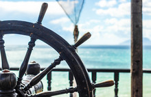 The Steering Wheel Of The Ship Against The Sky And Sea, Helm
