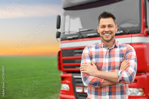 Fotomural Portrait of driver at modern truck outdoors. Space for text