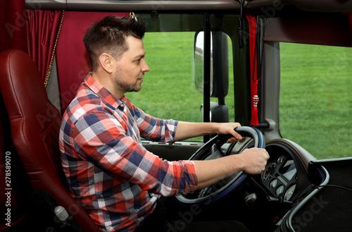 Cuadros en Lienzo Professional driver sitting in cab of modern truck