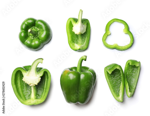 Whole and cut green bell peppers on white background, top view Fototapeta