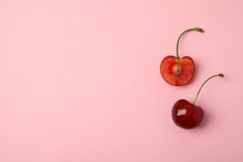 Cut And Whole Sweet Cherries On Pink Background, Top View. Space For Text
