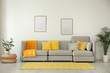 Leinwandbild Motiv Stylish living room interior with comfortable grey sofa