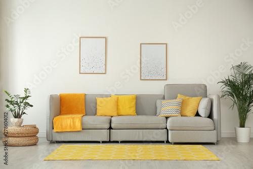 Stylish living room interior with comfortable grey sofa