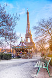 Fototapeta Fototapety Paryż - The Eiffel Tower and vintage carousel on a winter evening in Paris, France.