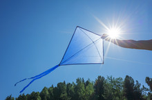 Blue Kite Soars In The Cloudle...
