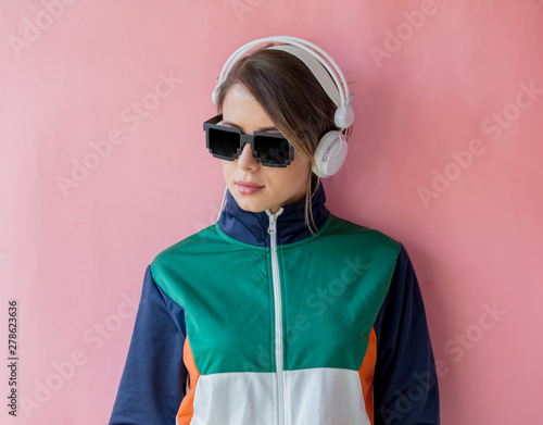 Young woman in 90s style clothes with headphones - Buy this