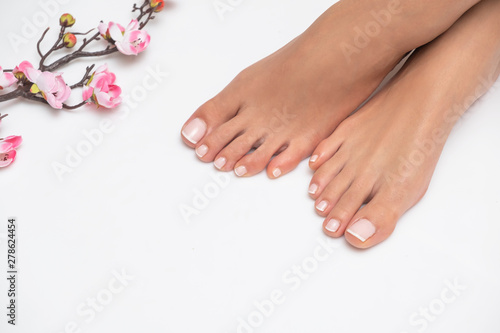Female feet with nice pedicure isolated on white background.