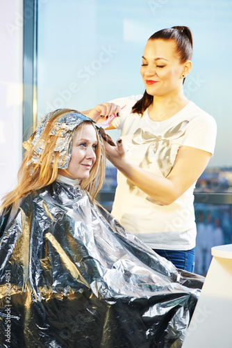 Highlight. woman hairdressing in beauty salon