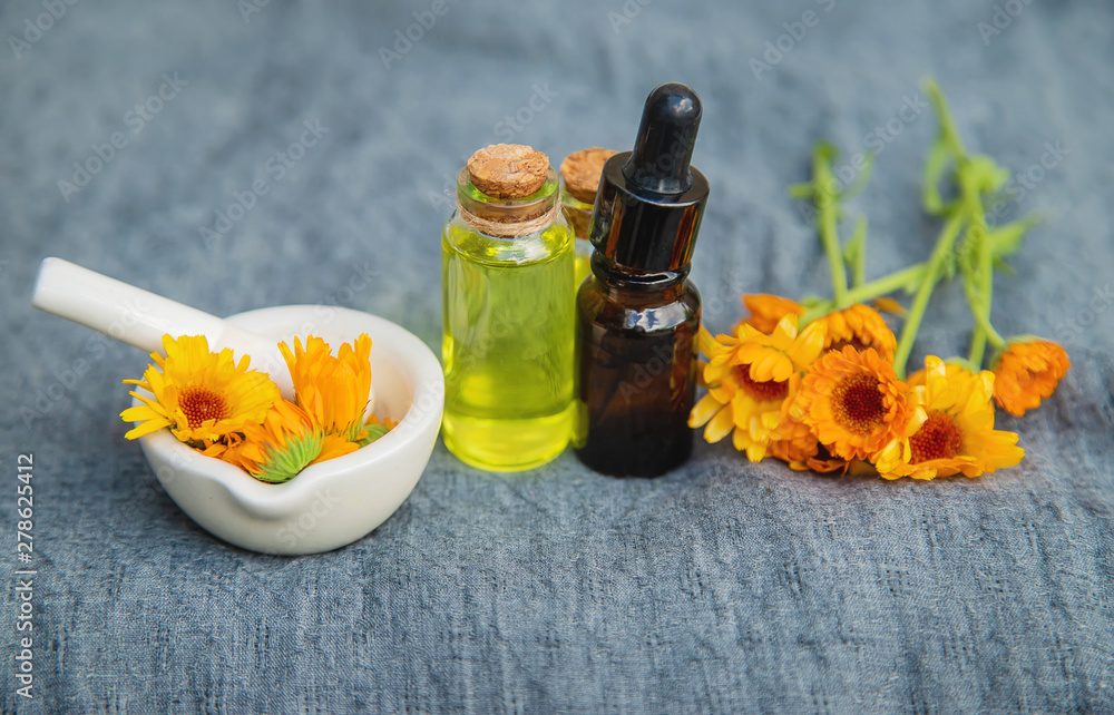 Fototapety, obrazy: The calendula extract. Selective focus.