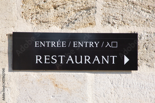 Poster de jardin Fleur arrow sign restaurant entry in multilingual
