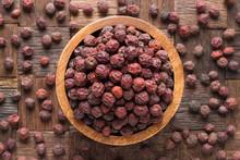 Dried Hawthorn Berries In Wood...