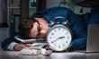 Leinwandbild Motiv Businessman working overtime long hours late in office
