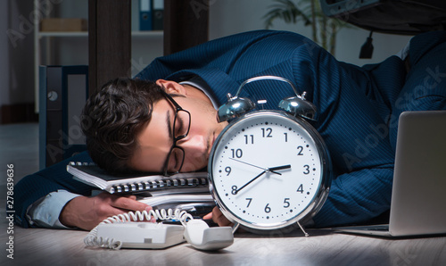 Deurstickers Snelle auto s Businessman working overtime long hours late in office