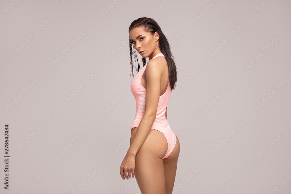 Fototapety, obrazy: Sexy woman in pink swimwear posing.