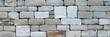 canvas print picture - Alte Steinmauer aus unterschiedlichen, viereckig gehauenen Natursteinen ohne Mörtel