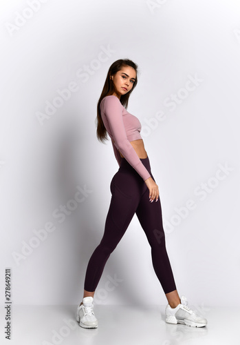 Sexy athletic woman sporty girl in fashion sportswear clothes stands posing afte Canvas Print