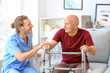 canvas print picture - Elderly man with caregiver in nursing home