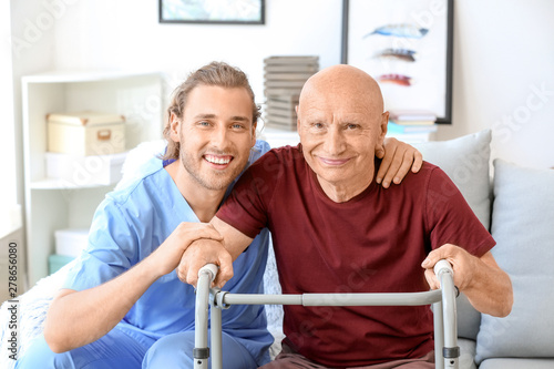 Photographie Elderly man with caregiver in nursing home