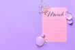 canvas print picture - Paper calendar, perfume, candle and flowers on color background