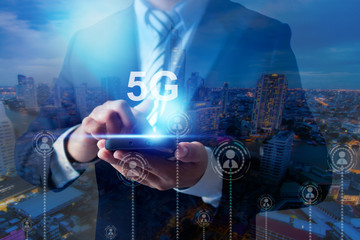 business man holding phone with network and social connection line of 5g technology