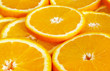 Orange fruits slices background