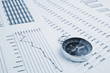 canvas print picture - Navigation in financial world, compass on financial charts and graphs