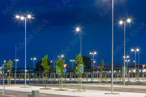 big modern empty parking area with LED street lights at evening