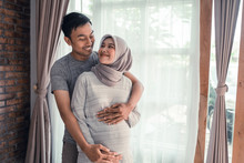 Pregnancy Muslim Woman. Happy ...