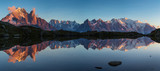 Panorama of the Mont Blanc massif reflected in Lac de Chesery during sunset. Chamonix, France.