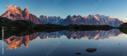 Printed kitchen splashbacks Mountains Panorama of the Mont Blanc massif reflected in Lac de Chesery during sunset. Chamonix, France.