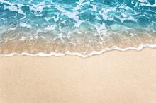 Soft Blue Ocean Wave On Clean Sandy Beach Background