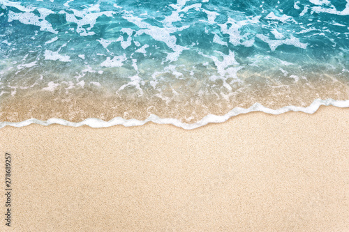 Printed kitchen splashbacks Beach Soft blue ocean wave on clean sandy beach background