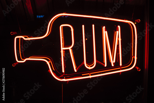 Neon sign in bar with text Rum