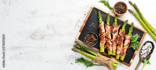 Fototapeta Asparagus baked with bacon and spices. Healthy food. Top view. Free space for your text. obraz
