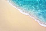 Fototapeta Fototapety z morzem do Twojej sypialni - Soft blue ocean wave on clean sandy beach