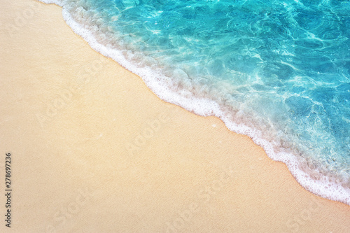 Photo sur Toile Plage Soft blue ocean wave on clean sandy beach