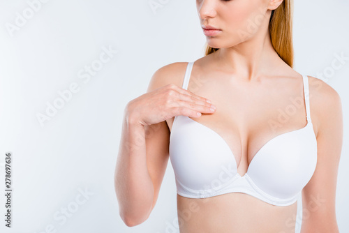 Cropped close-up view of perfect shape fit form curvy line girl touching mamma plastic surgery salon procedure isolated white background Wallpaper Mural