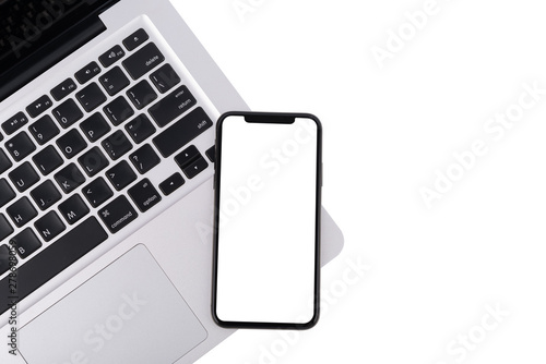 Fotografia, Obraz  Modern white office work table with smartphone mock up laptop ,top view