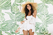 Photo Of Beautiful Brunette Woman In Straw Hat And Beach Clothes Smiling At Camera