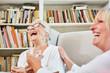 canvas print picture - Altenpflegerin und Senior Frau lachen zusammen