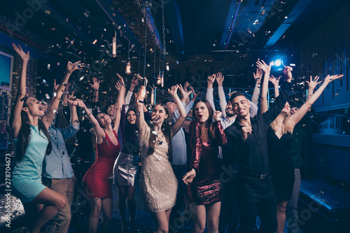 Portrait of good-looking festive lady guy having fun raise hands arms shout laugh emotional have vent holidays free time rejoice suit dress discotheque